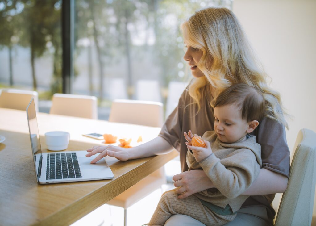 Woman Carrying Her Baby And Working On A Laptop 4079281 Reduced